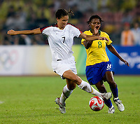 USWNT midfielder (7) Shannon Boxx takes the ball from Brazilian midfielder (8) Formiga while playing for the gold medal at Workers' Stadium.  The USWNT defeated Brazil, 1-0, during the 2008 Beijing Olympic final in Beijing, China.