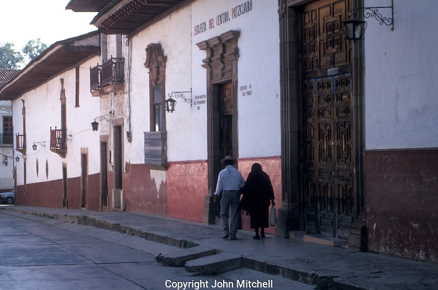 Elderly couple walkng down a typical street in the Spanish colonial town of Patzcuaro, Michoacan, Mexico