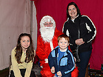 Kyle, Hannah and Caroline Heery pictured with Santa when he paid a visit to Slane. Photo:Colin Bell/pressphotos.ie