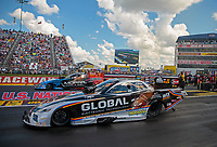 Sep 3, 2018; Clermont, IN, USA; NHRA funny car driver Shawn Langdon (near) races alongside Matt Hagan during the US Nationals at Lucas Oil Raceway. Mandatory Credit: Mark J. Rebilas-USA TODAY Sports
