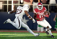 HAWGS ILLUSTRATED JASON IVESTER<br /> Arkansas freshman wide receiver Jojo Robinson tries to avoid Texas A&amp;M sophomore defensive back Armani Watts on Saturday, Sept. 26, 2015, at AT&amp;T Stadium in Arlington, Texas.