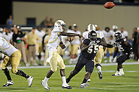 17 September 2011:  FIU linebacker Gregory Hickman (55) pressures UCF quarterback Jeff Godfrey (2) in the second half as the FIU Golden Panthers defeated the University of Central Florida Golden Knights, 17-10, at FIU Stadium in Miami, Florida.