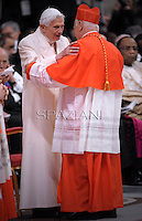 Chilean cardinal Ricardo Ezzati Andrello is congratulated by Pope emeritus Benedict XVI  after he was appointed cardinal by the Pope at the consistory in the St. Peter's Basilica at the Vatican on February 22, 2014.
