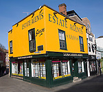 Brightly coloured building of estate agency business in the town centre, Colchester, Essex, England