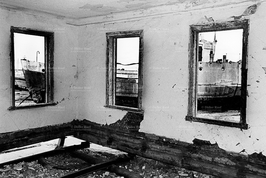 Kazakhstan. Aralsk. Harbour. Derelict house. Dried up (dry bed) Aral Sea with abandoned russian fishing boat litter the dry landscape where the Aral sea once called home until it started to dry up due to overuse of water resources at the time of former Soviet Union. The causes were human and environmental effects of industrial pollution with consequences for the Aral sea to dry up, then shrink and become now two shallow lakes far from the old shore (100 km distant). © 2008 Didier Ruef ..... ..