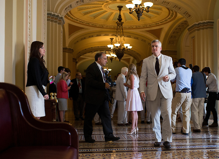UNITED STATES - JUNE 11: Sen. Bill Cassidy, R-La., arrives with fellow Senators in the Ohio Clock Corridor for the Official National Seersucker Day Photograph in celebration of National Seersucker Day on Thursday, June 11, 2015. Continuing the tradition introduced by Sen. Trent Lott (R-MS) in 1996, Dr. Cassidy reintroduced National Seersucker Day in the U.S. House of Representatives in 2014 and is continuing the tradition in the U.S. Senate. (Photo By Bill Clark/CQ Roll Call)