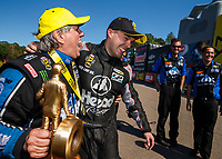 Mar 19, 2017; Gainesville , FL, USA; NHRA funny car driver John Force (left) greets runner up Jonnie Lindberg as he celebrates after winning the Gatornationals at Gainesville Raceway. Mandatory Credit: Mark J. Rebilas-USA TODAY Sports