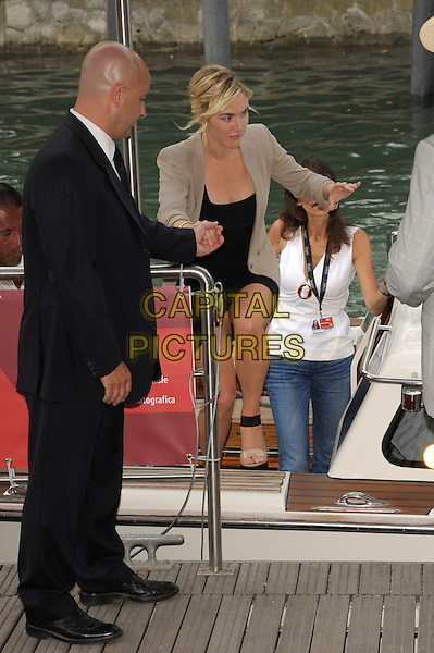 Kate Winslet .Arrives by boat for the 'Carnage' photocall at the Palazzo del Casino during the 68th Venice Film Festival, Venice, Italy, September 1st 2011..full length  black jacket blazer beige sandals dress getting stepping out off helped  assistant .CAP/PL.©Phil Loftus/Capital Pictures.