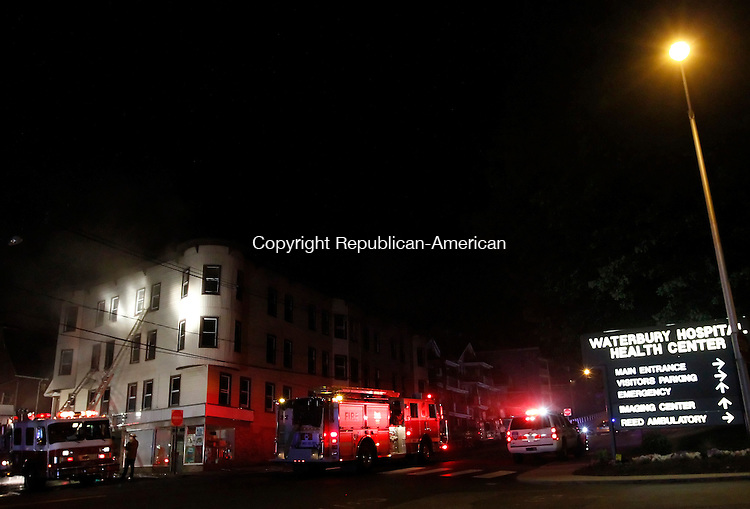 Waterbury, CT-27, May 2010-052710CM20 Fire officials work a scene on Colley St. across the entrance to Waterbury Hospital late Thursday evening.  A fire hit several apartments on this vacant building.   --Christopher Massa Republican-American