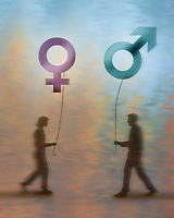 Man and woman approaching each other with gender symbol balloons