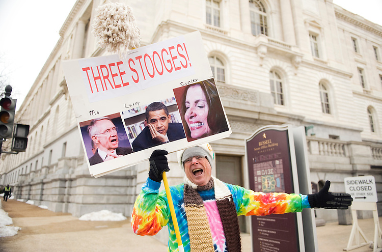 Kevin McCracken, of Stevensville, Md., yells at the departing car of Senate Minority Leader Harry Reid, D-Nev., outside of Russell Building, Feb. 19, 2010.  McCracken walked near Russell Building shouting out numerous grievances he has with Congress.