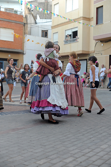 Young women perform traditional dances of the Valencian region in the main square during the municipal fiestas in Costur, Spain on August 15, 2009.