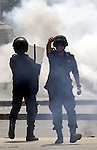 Egyptian security forces take up position during as supporters of ousted President Mohammed Morsi protest outside Cairo University in Giza, near Cairo, May 20, 2014. Security forces used tear gas to disperse students who protested outside their campus Wednesday. Photo by Mohammed Bendari