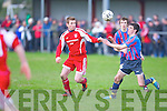 Dingle Bay Rovers James Coffey and Carndonogh FC's Oliver McConalogue...