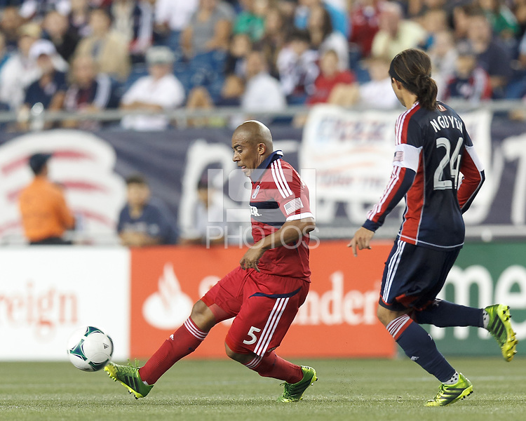 Chicago Fire midfielder Arevalo Rios (5) passes the ball.  In a Major League Soccer (MLS) match, the New England Revolution (blue) defeated Chicago Fire (red), 2-0, at Gillette Stadium on August 17, 2013.