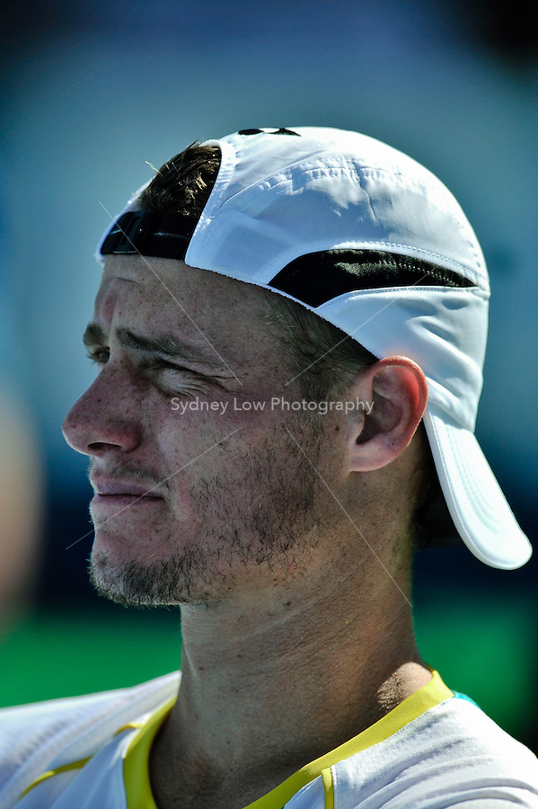 MELBOURNE, 15 JANUARY - Lleyton Hewitt (AUS) watches the preparation of the winner's presentation after winning the final of the 2011 AAMI Classic against Gael Monfils (FRA) at Kooyong Tennis Club in Melbourne, Australia. (Photo Sydney Low / syd-low.com)