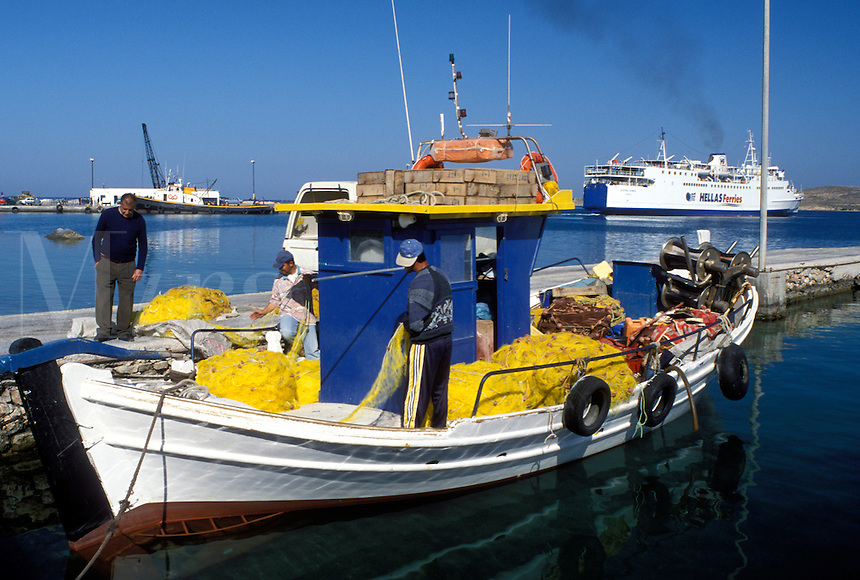 Paros, Greek Islands, Parikia, Cyclades, Greece, Europe, Fishermen on fishing boat docked in the harbor of Parikia on Paros Island on the Aegean Sea.