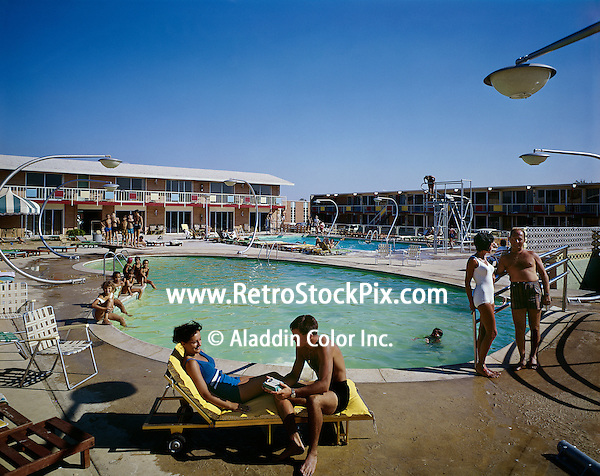 Group of people enjoying the large pool and deck at the Country Squire Motel in Cherry Hill, NJ. 1960's photograph.