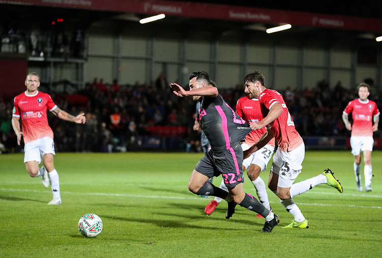 Leeds United's Jack Harrison appears to be pulled back i the box by Salford City's Joey Jones<br /> <br /> Photographer Alex Dodd/CameraSport<br /> <br /> The Carabao Cup First Round - Salford City v Leeds United - Tuesday 13th August 2019 - Moor Lane - Salford<br />  <br /> World Copyright © 2019 CameraSport. All rights reserved. 43 Linden Ave. Countesthorpe. Leicester. England. LE8 5PG - Tel: +44 (0) 116 277 4147 - admin@camerasport.com - www.camerasport.com