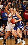 SIOUX FALLS, SD - FEBRUARY 28:  Peyton Bjorkman #23 from O'Gorman looks to the basket past Lauren Kunz #21 from Roosevelt in the second half of their District 1AA Championship Game Thursday night at Roosevelt. (Photo by Dave Eggen/Inertia)