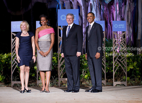United States President Barack Obama (R) and First Lady Michelle Obama (2nd L) pose for a portrait with Prime Minister Stephen Harper of Canada (2nd R) and his wife Laureen Harper (L) before the Asia-Pacific Economic Cooperation (APEC) summit dinner at the Hale Koa Hotel in Honolulu, Hawaii on Saturday, November 12, 2011..Credit: Kent Nishimura / Pool via CNP