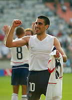 Claudio Reyna celebrates after advancing to the quarterfinal round. The USA defeated Mexico 2-0 in the Round of 16 of the FIFA World Cup 2002 in South Korea on June 17, 2002.