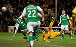 Michael Higdon scores with an overhead kick