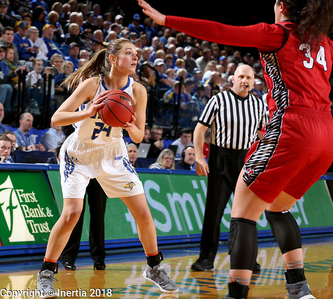 BROOKINGS, SD - JANUARY 25: Tagyn Larson #24 from South Dakota State University looks for a teammate past Kate Liveringhouse #34 from the University of South Dakota during their game Thursday night at Frost Arena in Brookings. (Photo by Dave Eggen/Inertia)