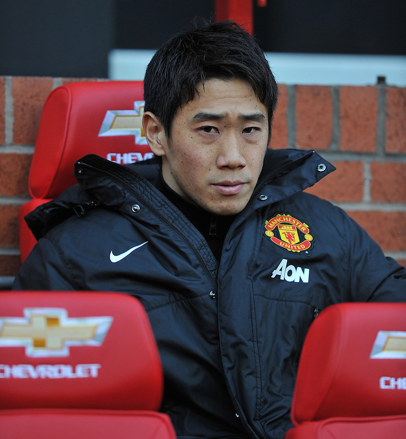 Manchester United's Shinji Kagawa takes his place on the bench before kick off<br /> Photo by Dave Howarth/CameraSport<br /> <br /> Football - Barclays Premiership - Manchester United v Fulham - Sunday 9th February 2014 - Old Trafford - Manchester<br /> <br /> &copy; CameraSport - 43 Linden Ave. Countesthorpe. Leicester. England. LE8 5PG - Tel: +44 (0) 116 277 4147 - admin@camerasport.com - www.camerasport.com