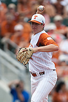 Texas Longhorns pitcher Parker French #24 attempts a pickoff during the NCAA baseball game against the Texas A&M Aggies on April 28, 2012 at UFCU Disch-Falk Field in Austin, Texas. The Aggies beat the Longhorns 12-4. (Andrew Woolley / Four Seam Images).