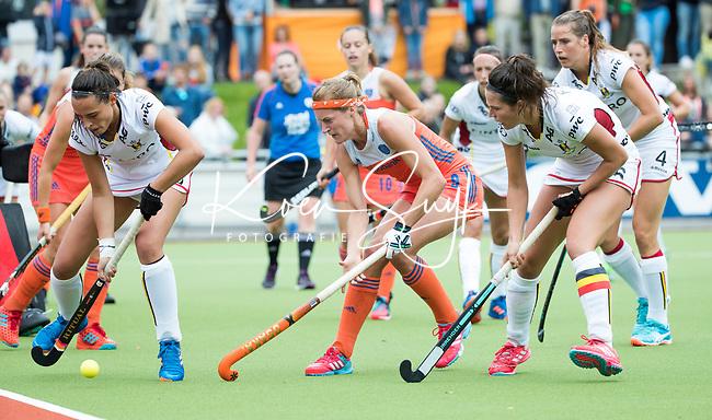 SCHIEDAM - Carlien Dirkse van den Heuvel (Ned)  met links Lien HILLEWAERT (Bel)   tijdens een oefenwedstrijd tussen  de dames van Nederland en Belgie , in aanloop naar het  EK Hockey, eind augustus in Amstelveen. COPYRIGHT KOEN SUYK