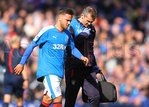 10.04.2016. Hampden Park, Glasgow, Scotland. Petrofac Training Cup Final. Rangers versus Peterhead. Harry Forrester leaves the park after picking up an injury