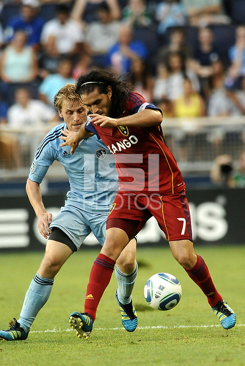 Fabian Espindola, Real Salt Lake (red) hold off the challenge of Sporting KC defender Seth Sinovic... Sporting Kansas City defeated Real Salt Lake 2-0 at LIVESTRONG Sporting Park, Kansas City, Kansas.