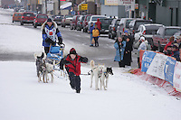 Tyrell Seavey at the Nome finish line.     End of the  2005 Iditarod Trail Sled Dog Race.