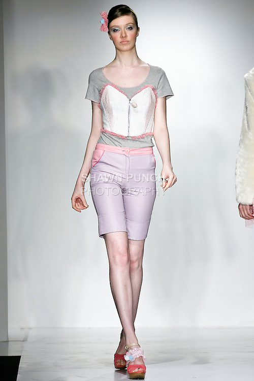 Model walks the runway in a Love & Candy outfit, designed by Mayu Samoto, during the Pratt Institute 2010 Fashion Show on May 13, 2010.