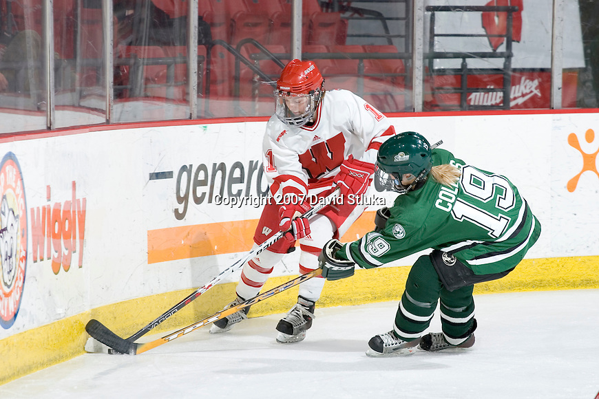 MADISON, WI - FEBRUARY 16: Kyla Sanders #11 of the Wisconsin Badgers women's hockey team battles for the puck against Brooke Collins #19 of the Bemidji State Beavers at the Kohl Center on February 16, 2007 in Madison, Wisconsin. The Badgers beat the Beavers 2-0. (Photo by David Stluka)