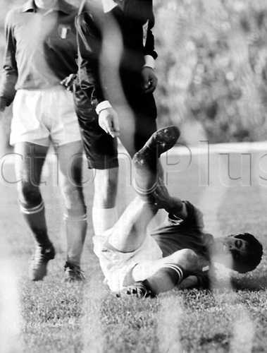 Tumultuous scenes during the Soccer World Cup group game Chile versus Italy in the National Stadium in Santiago de Chile, Chile, 2 June 1962. Italian player Sandro Salvadore lies on the ground and holds his knee. The game developed into an infamous game of scandal due the amount of assaults and fouls on the pitch. In the end Chile won the game 2-0 against Italy in front of 66,000 spectators.