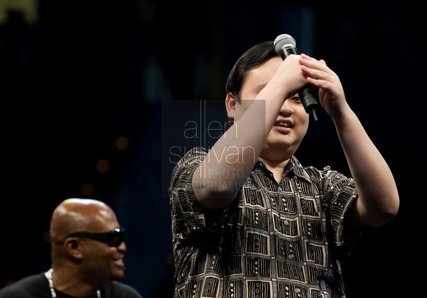 """Former """"American Idol"""" contestant William Hung sings during a Dreams N2 Reality show and casting call at Philips Arena in Atlanta on Saturday, August 4, 2007. People offered their auditions in hopes of gaining spots on game shows and others in the reality TV genre. Former """"Real World"""" star Syrus sits behind."""