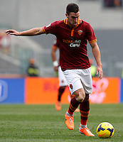 Calcio, Serie A: Roma-Genoa. Roma, stadio Olimpico, 12 gennaio 2014.<br /> AS Roma midfielder Kevin Strootman, of the Netherlands, in action during the Italian Serie A football match between AS Roma and Genoa, at Rome's Olympic stadium, 12 January 2014. <br /> UPDATE IMAGES PRESS/Riccardo De Luca