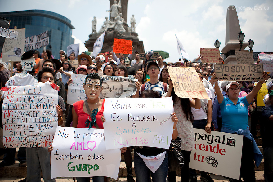 24 June 2012 - Mexico City, Mexico - Thousands of demonstrators and university students members of the movement ?yo soy 132? (I am 132) take part in a protest against Enrique Pena Nieto, presidential candidate of the opposition Institutional Revolutionary Party (PRI) and media censorship in the electoral campaign before the presidential elections of July 1 at the Monument of the Angel of Independence in Mexico City. Photo credit: Benedicte Desrus