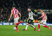 31st January 2020; Pride Park, Derby, East Midlands; English Championship Football, Derby County versus Stoke City; Wayne Rooney of Derby County passing the ball as he gets away from Tom Ince of Stoke City