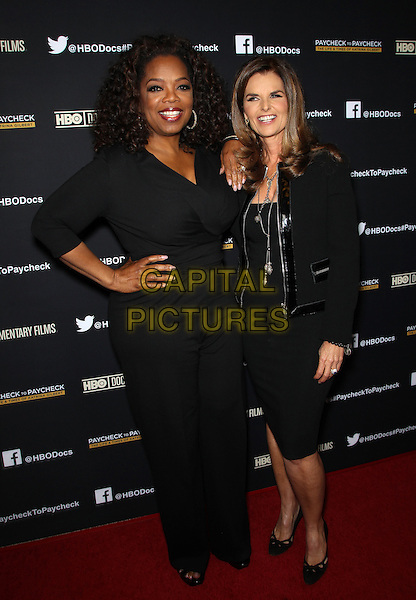 Hollywood, CA - March 10: Oprah Winfrey, Maria Shriver Attending Premiere Of HBO Documentary Films' &quot;Paycheck To Paycheck&quot;, Held at Linwood Dunn Theater California on March 10, 2014.<br /> CAP/MPI/RTNUPA<br /> &copy;RTNUPA/MediaPunch/Capital Pictures