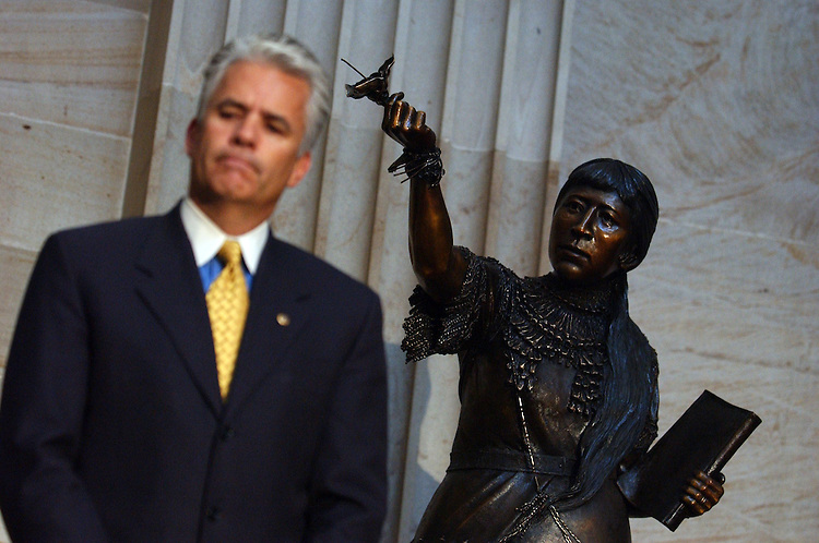 Sen. John Ensign, R-Nev., stands near a statue of Sarah Winnemucca that was added to the Capitol's collection.