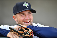Left fielder Tim Tebow (15) of the Columbia Fireflies looks on from the dugout before a game against the Augusta GreenJackets on Opening Day, Thursday, April 6, 2017, at Spirit Communications Park in Columbia, South Carolina. (Tom Priddy/Four Seam Images)