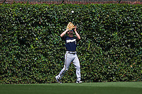 Milwaukee Brewers outfielder Logan Schafer (7) catches a fly ball during a game against the Chicago Cubs on August 13, 2015 at Wrigley Field in Chicago, Illinois.  Chicago defeated Milwaukee 9-2.  (Mike Janes/Four Seam Images)