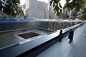 United States President Barack Obama and First Lady Michelle Obama, along with former President George W. Bush and former First Lady Laura Bush, pause at the North Memorial Pool of the National September 11 Memorial in New York, New York, on the tenth anniversary of the 9/11 attacks against the United States, Sunday, September 11, 2011. The North Memorial pool sits in the footprint of the north tower, formerly 1 World Trade Center..Mandatory Credit: Chuck Kennedy - White House via CNP