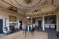 The plasterwork in the spacious entrance hall was coloured and gilded in 1877