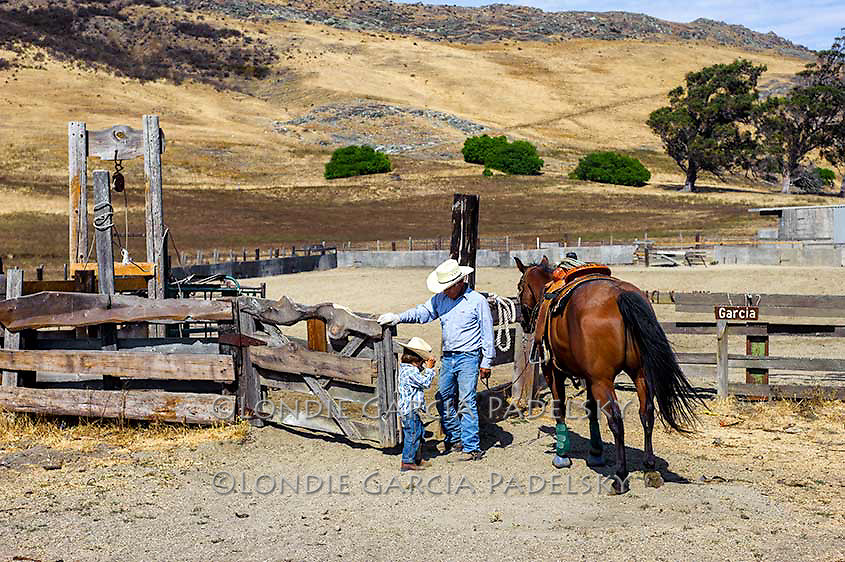 Grandpa with grandson at the roping arena. San Luis Obispo, California  <br /> (Roy Garcia and Bode)