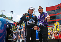 Jun 18, 2017; Bristol, TN, USA; NHRA funny car driver John Force (left) talks with Jack Beckman during the Thunder Valley Nationals at Bristol Dragway. Mandatory Credit: Mark J. Rebilas-USA TODAY Sports