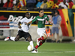 1 March 2006: Ghana's John Mensah (l) and Mexico's Omar Bravo (11) chase the ball. The National Team of Mexico defeated the National Team of Ghana 1-0 at Pizza Hut Park in Frisco, Texas in an International Friendly soccer match.